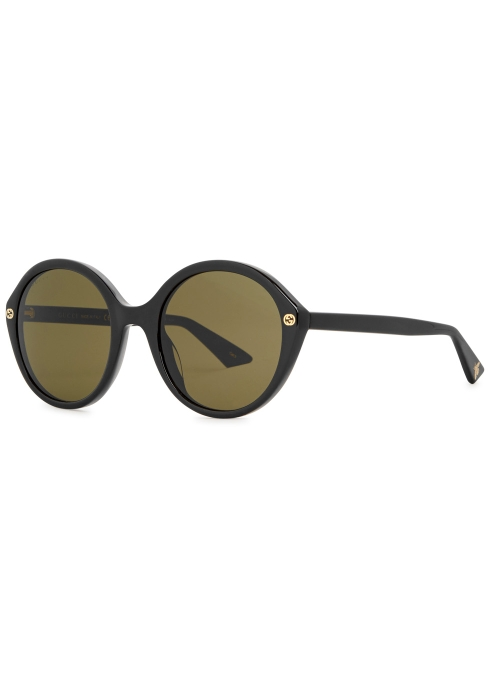 363fec637db Gucci GG black round-frame sunglasses - Harvey Nichols