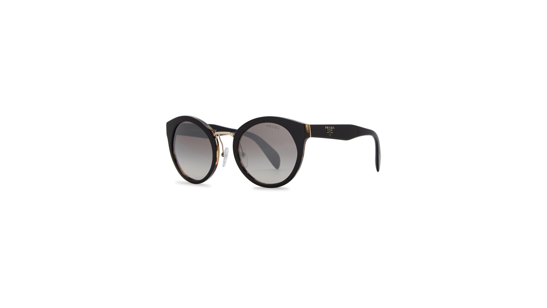 7fad77ed36 Prada Black cat-eye sunglasses - Harvey Nichols