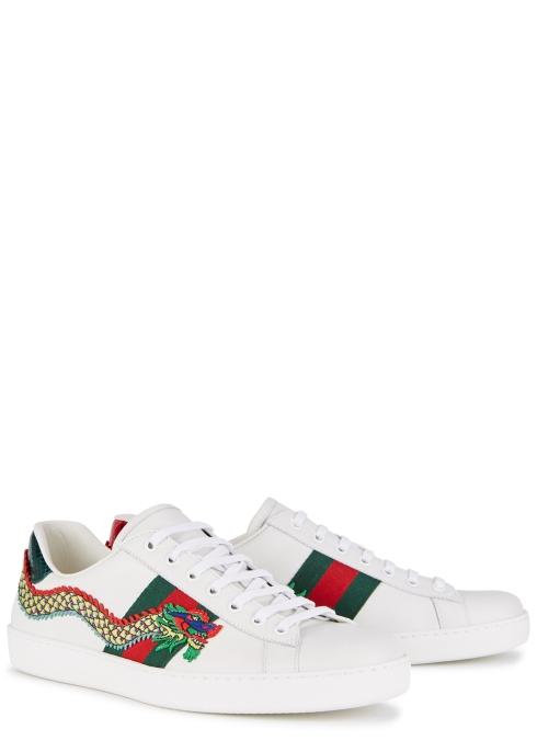 35e18728ebe Gucci New Ace dragon-appliquéd leather trainers - Harvey Nichols