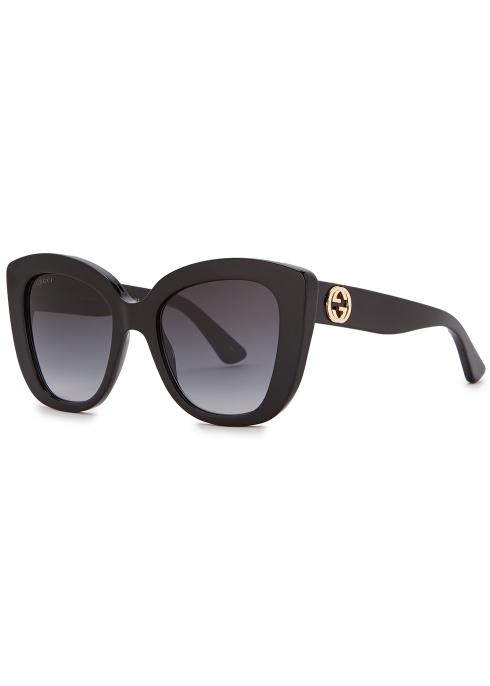 f4fd314aaf769 Gucci Black cat-eye sunglasses - Harvey Nichols