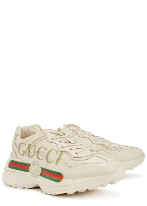 3eb08dbfc01 Gucci Rhyton logo-print leather trainers - Harvey Nichols