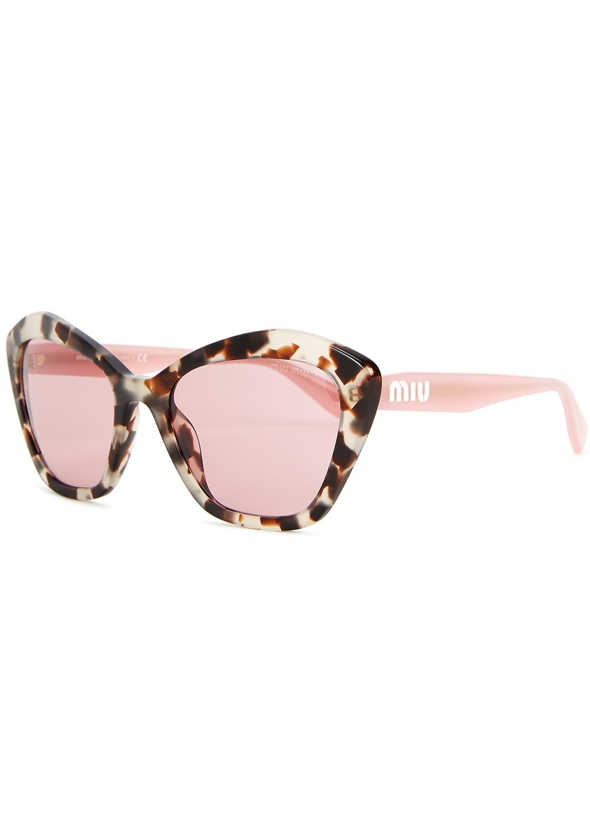 805b4cbfae8 Tortoiseshell cat-eye sunglasses. Miu Miu