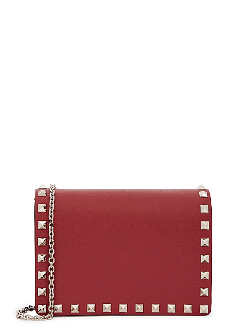 581e6d571 Valentino Garavani Rockstud red leather clutch - Harvey Nichols