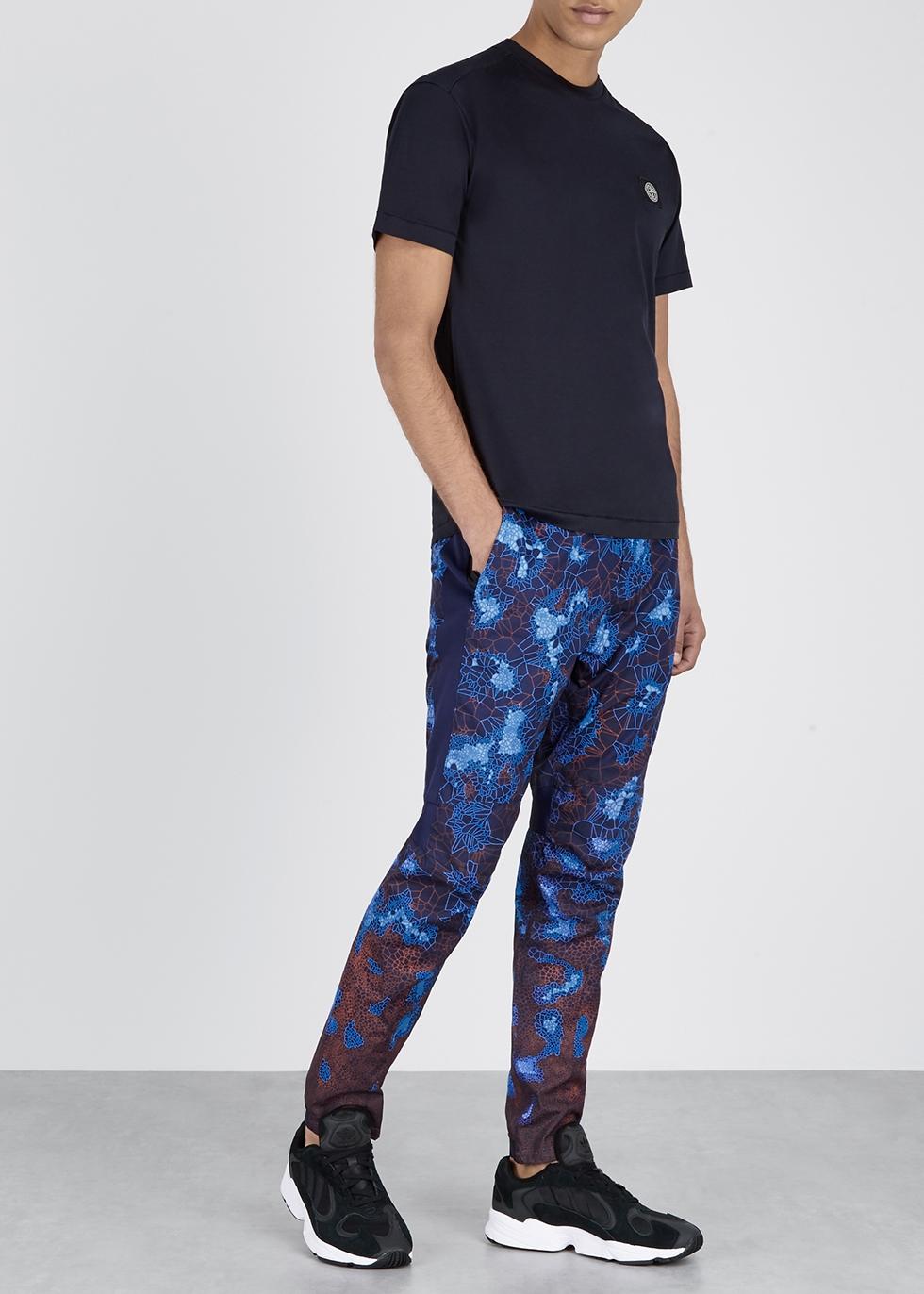 Heat-reactive navy cotton trousers - Stone Island