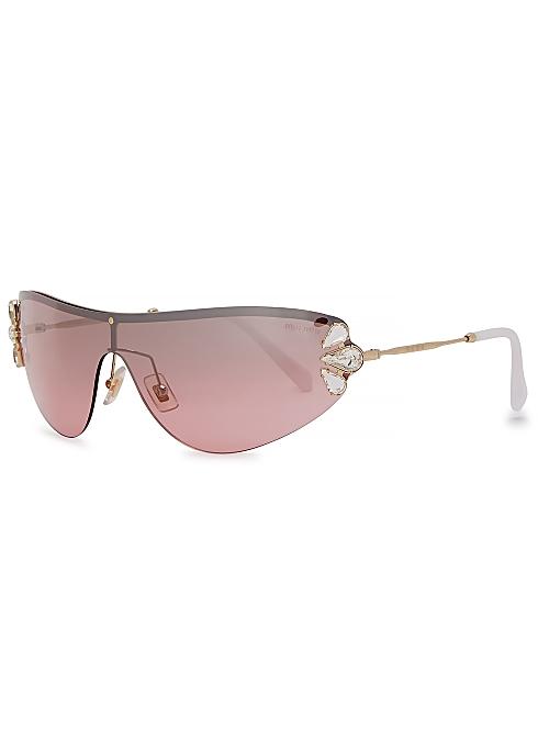 b6649ae4da22 Miu Miu Pink embellished wrap-around sunglasses - Harvey Nichols