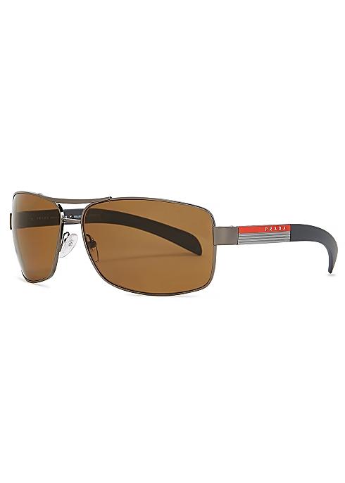 0ab9cd493 Prada Linea Rossa Gunmetal oval-frame sunglasses - Harvey Nichols