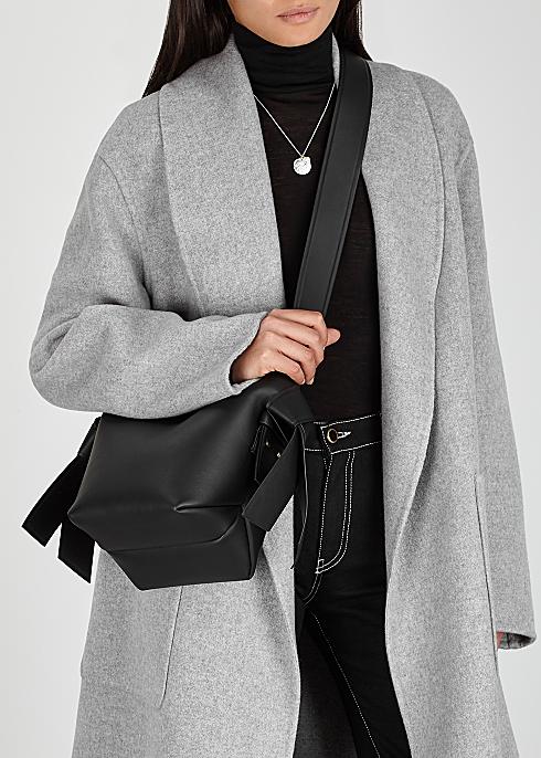 good texture extremely unique high fashion Acne Studios Musubi mini black leather cross-body bag ...