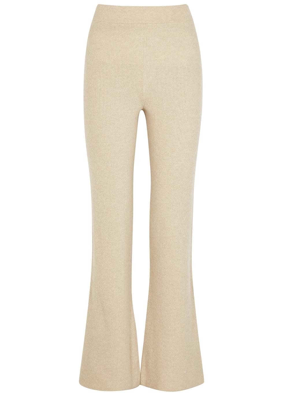 Leba ecru flared wool-blend trousers