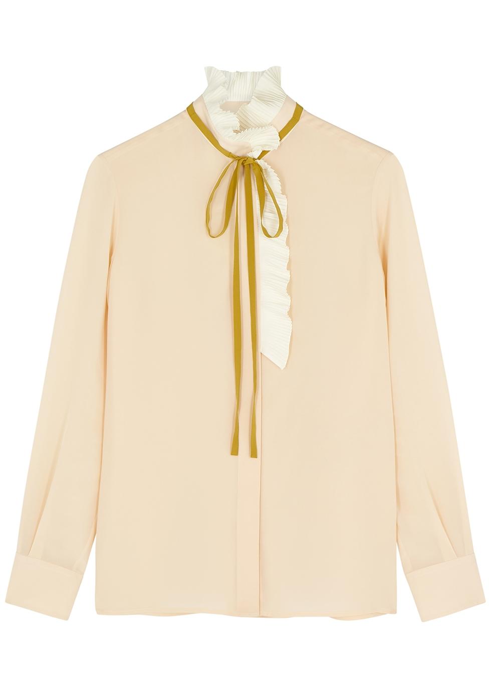 Peach ruffle-trimmed silk blouse