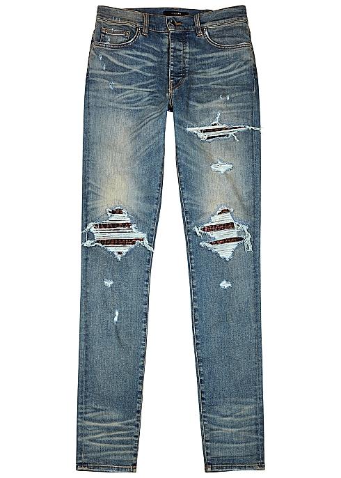AMIRI MX1 blue distressed skinny jeans