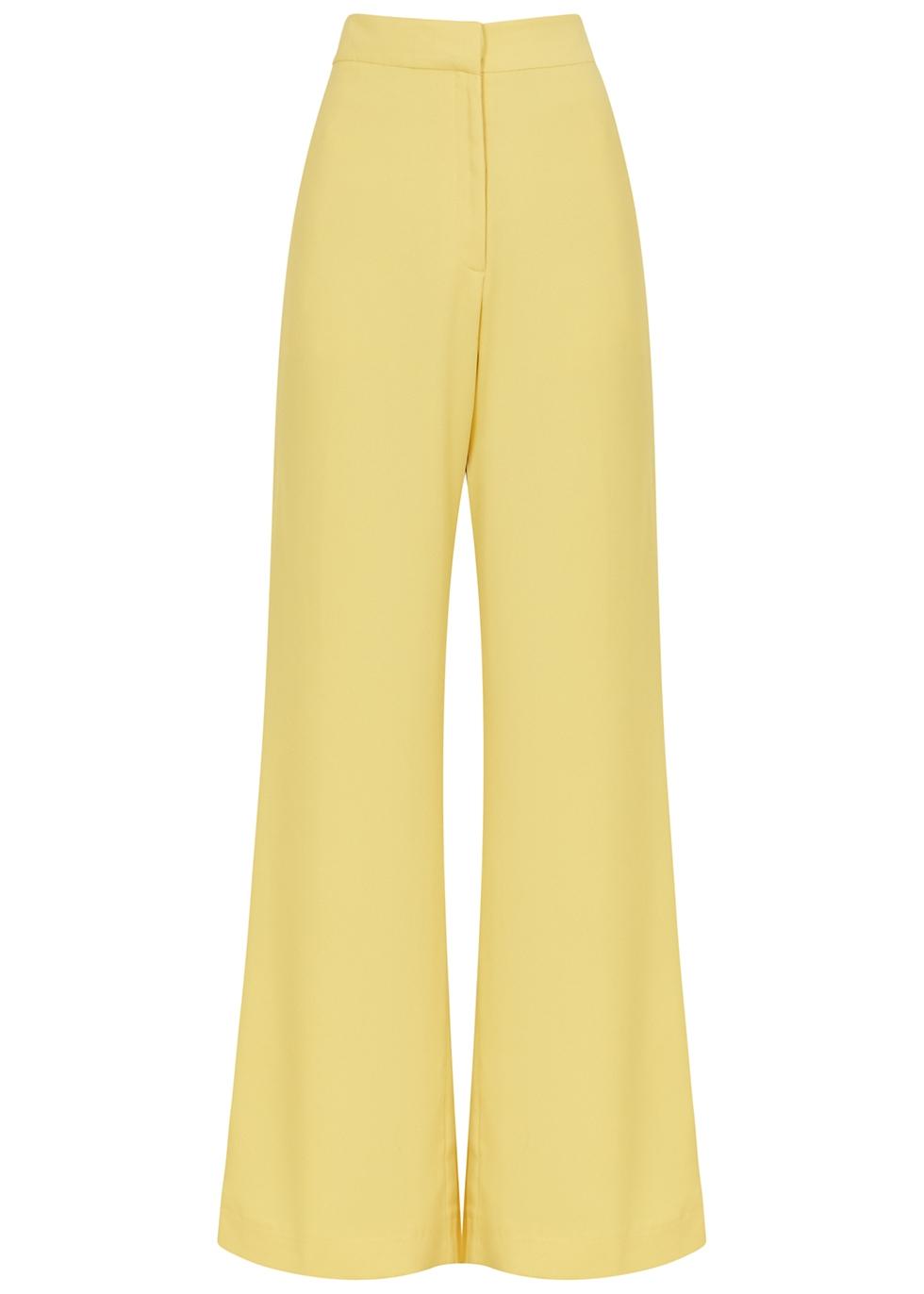Uma yellow flared trousers